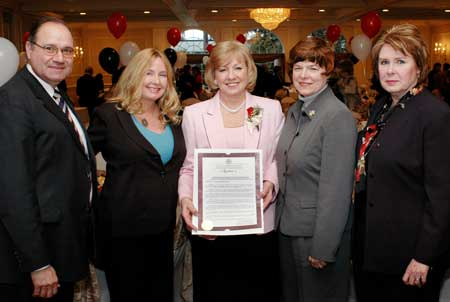 Karen Lukenda (center) is honored by the Union County Freeholders