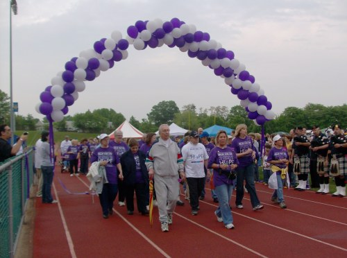 "Cancer survivors walk in the ""Survivor Celebration Opening Lap"" at American Cancer Society-Relay For Life of Cranford, on Friday, May 29. (Photo credit: Ruthanne Brown)"
